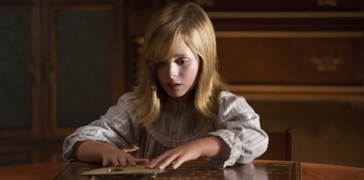 """They're Here!"" Lulu Wilson as Doris in Ouija: Origin of Evil (2016). Image courtesy of Universal."