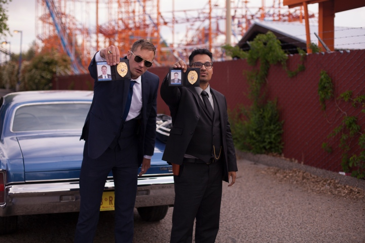 Showing off their credentials: Terry (Alexander Skarsgard) and Bob (Michael Pena). War On Everyone (2016), image courtesy of Icon Films.