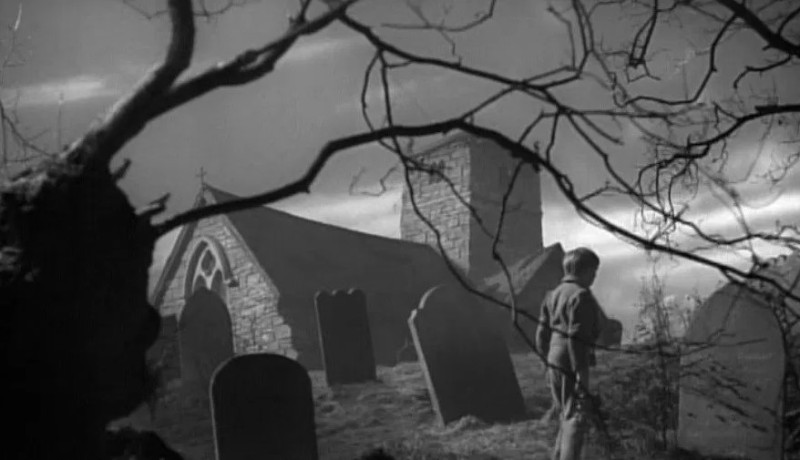 Pip walking through a graveyard in the film Great Expectations 1946